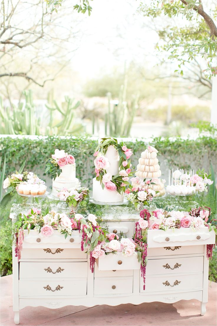 Dessert table - white cakes with soft pink floral accents on a vintage dresser