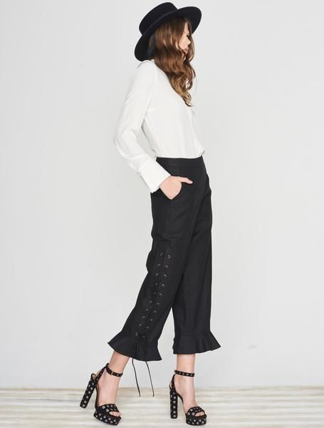 ISLA SERGIO FLARED PANT Rocking the romantic glamour of the 70's. These black linen cropped pants have a flattering high-rise, lace-up eyelet detailing down the sides, and a ruffled cropped hem. Available www.islalabel.com
