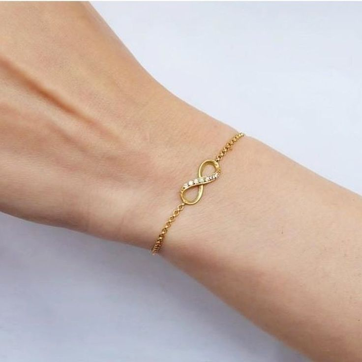 Gold Bracelet This bracelet has stones on top and symbolises that love has no beginning or end. Made with yellow gold plated sterling silver and 7 cubic zirconia.