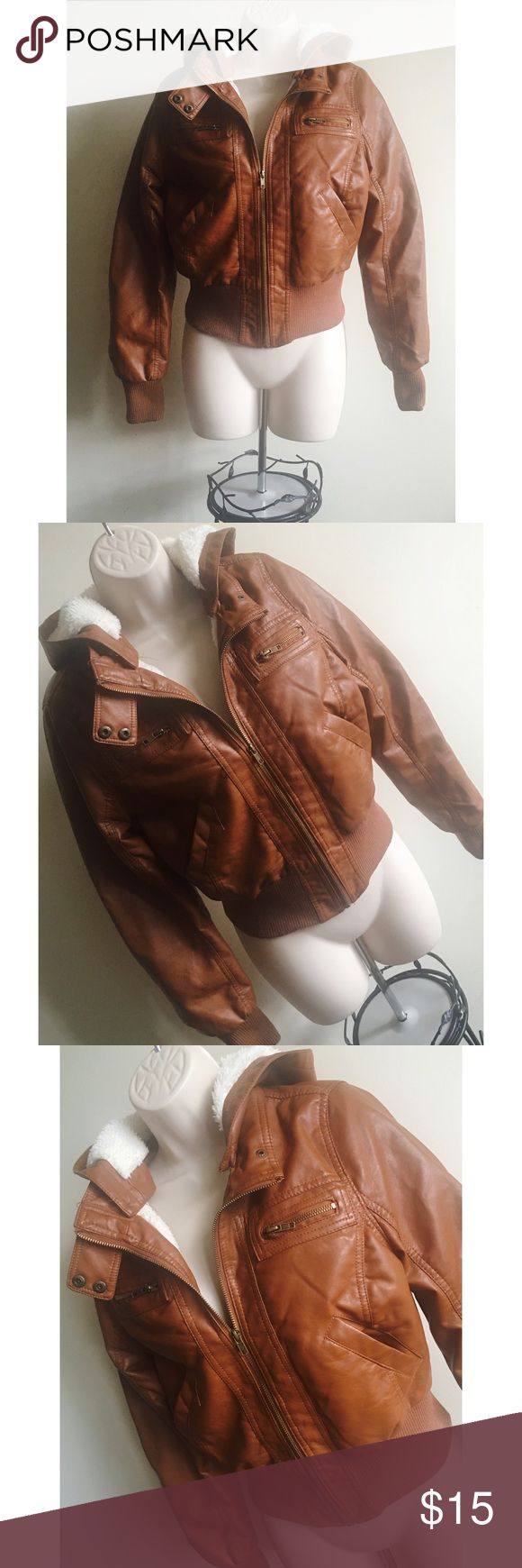 Faux Leather Jacket Brown Faux Leather Jacket with Detachable Hood in very good condition Any Questions Please Ask before Purchase No Paypal || No Trades || Posh Rules Only  Shipping:  Bundle and Save on Shipping / 20% off 3 or More Items Items are shipped within 24-48 hours of payment (Mon-Fri.)  Please Check Out my other listings for the best in brand new and gently used clothing, shoes and accessories. Happy Poshing!!! Ambiance Apparel Jackets & Coats