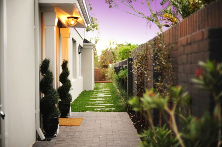 Hampton Style Homes Garden and side entry to home, by the team at nhbb.com.au