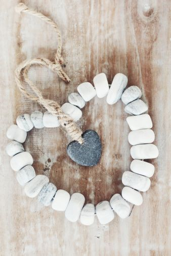 Royalty-free Image: Stone heart on a wooden table