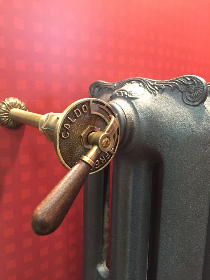 Artistic radiator valve with wooden handle installed on Liberty cast iron radiator