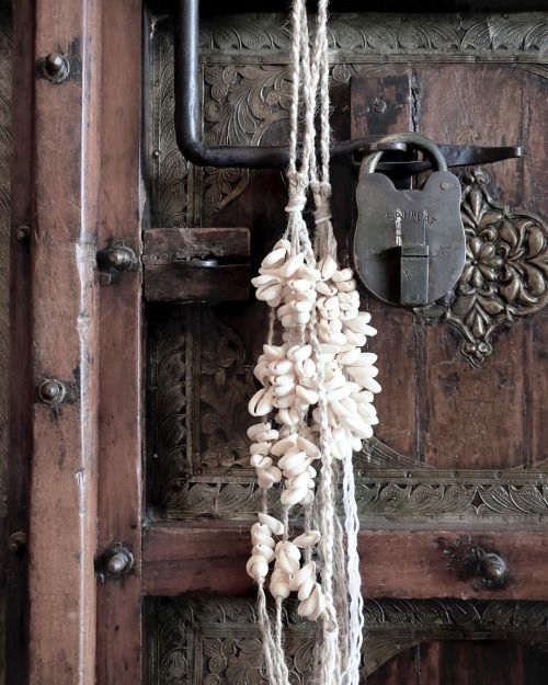 A perfect example of how amazing our Jute Cowrie Tassels look hanging from a door. Love this image via @villagestores  ••  >Featured: Jute Cowrie Tassel  >Listed under: Tassels  Online: www.aboynamedaaron.com.au (at Gold Coast, Queensland)