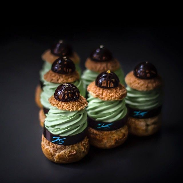 """Triangle des Choux."" Six small puffs of buttery pastry dough, each topped with chocolate, green tea cream, mascarpone, coconut crisp."