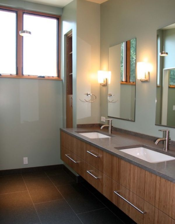 Simple and chic contemporary bathroom with undrmount sinks and wooden furniture