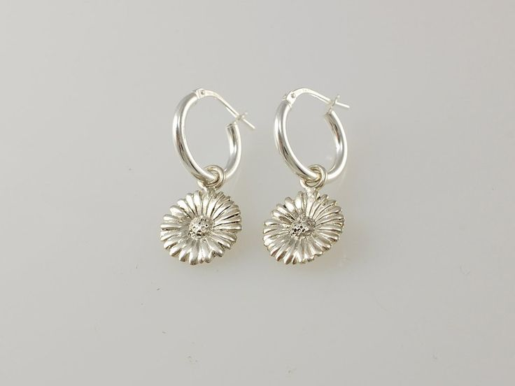 -Daisy Hoop Earrings- NZ$119- Silver. Our silver daisy hoop earrings are a very popular gift. Do you remember sitting in the summer sun creating long daisy chains? Sadly they only last a short time but our silver daisies are everlasting! The daisy collection includes pendants, hoops earrings, studs and the daisy chain necklace. Daisy size 12.5mm, sterling silver hoops are 14mm diameter. Jewellery made @jewelbeetle in Nelson, New Zealand.