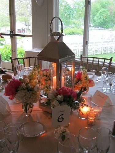 White lantern centerpiece candle inside and bridal