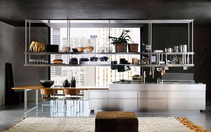 Cucina ARCLINEA modello Convivium in acciaio inox. La storia della passione per la tecnologia e funzionalità in cucina.