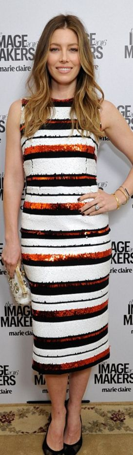 Who made  Jessica Biel's gold jewelry, black mesh pumps, and white stripe sequin dress?