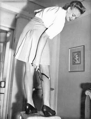Women painting back seams on legs during WWII to imitate stockings , Nylon stockings became unavailable because nylon was needed for war purposes.