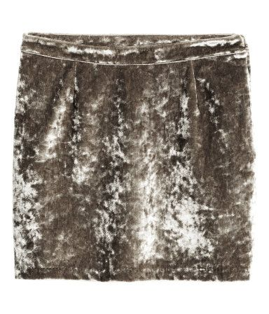 Taupe. Short skirt in stretch velvet with a concealed side zip. Unlined.
