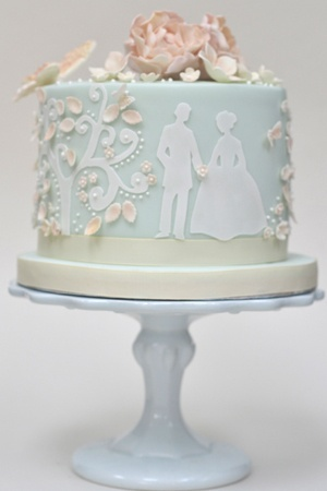 Best use of a cricut cake i've seen yet! could also be hand cut from wafer paper or icing sheets.. Blue Fairytale Wedding Cake
