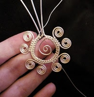 This site has some great tutorials for wire work. This one says Jana to me.