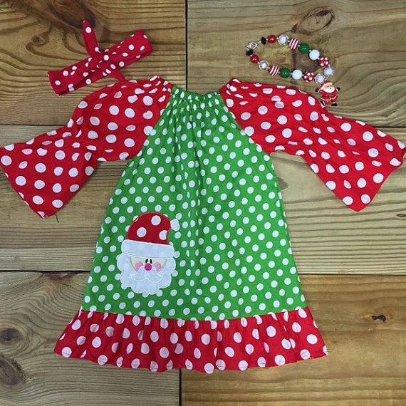 "Girl's red & green polka dot Christmas dress with Santa applique. Add Accessories Just choose ""With Accessories"" when choosing size. Cotton/Spandex True To Size Order the size she normally wears every"