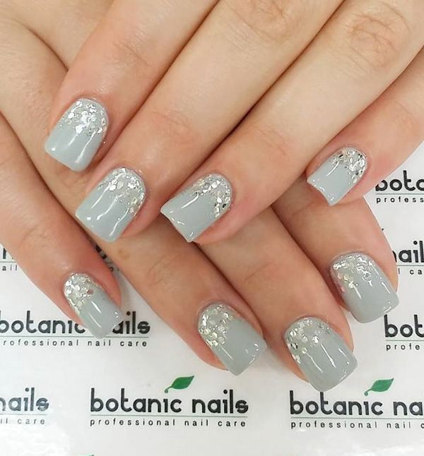 Blue gray and sequins nail art. Light and cheery looking nail art with the help of silver sequins added on top near the cuticle part of the nails.