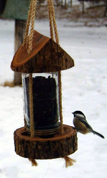 Picture of Mason Jar Log Bird Feeder submitted to the Instructables Mason Jar Contest by www.rusticwoodworking.com