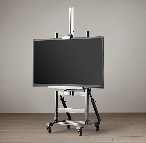 RH's TV Easel - Gunmetal:We've repurposed the artist's easel to give televisions, mirrors and other wall décor a home worthy of a gallery setting. Placed on casters and fashioned from an adjustable base of metal and wood, our sturdy easel can be positioned precisely as desired.