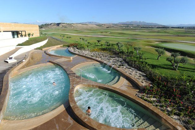 Verdura Golf & Spa Resort in Sciacca, Italy has pools that overlook the gold courses. #spa (Photo courtesy of Verdura Golf & Spa Resort):