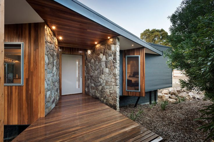 Entrance.  Rock wall combined with wood and steel cladding - love it.  Warragul Project www.maxadesign.com.au
