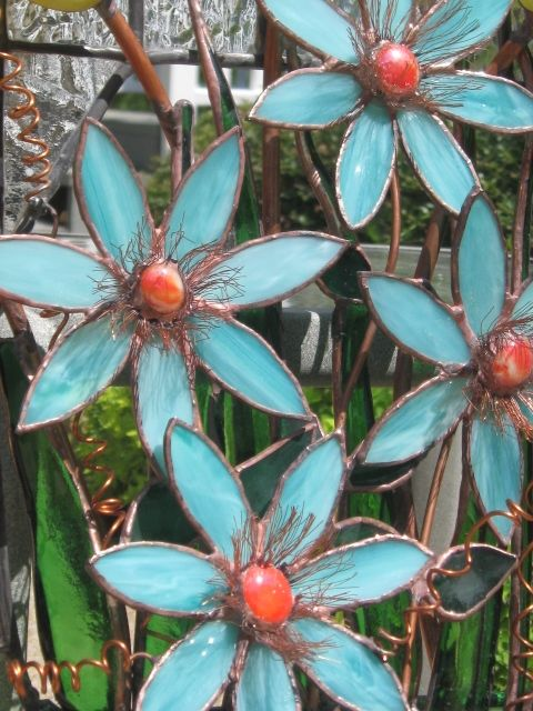 stained glass aqua flowers with orange centers by Marlene Kerley Adams