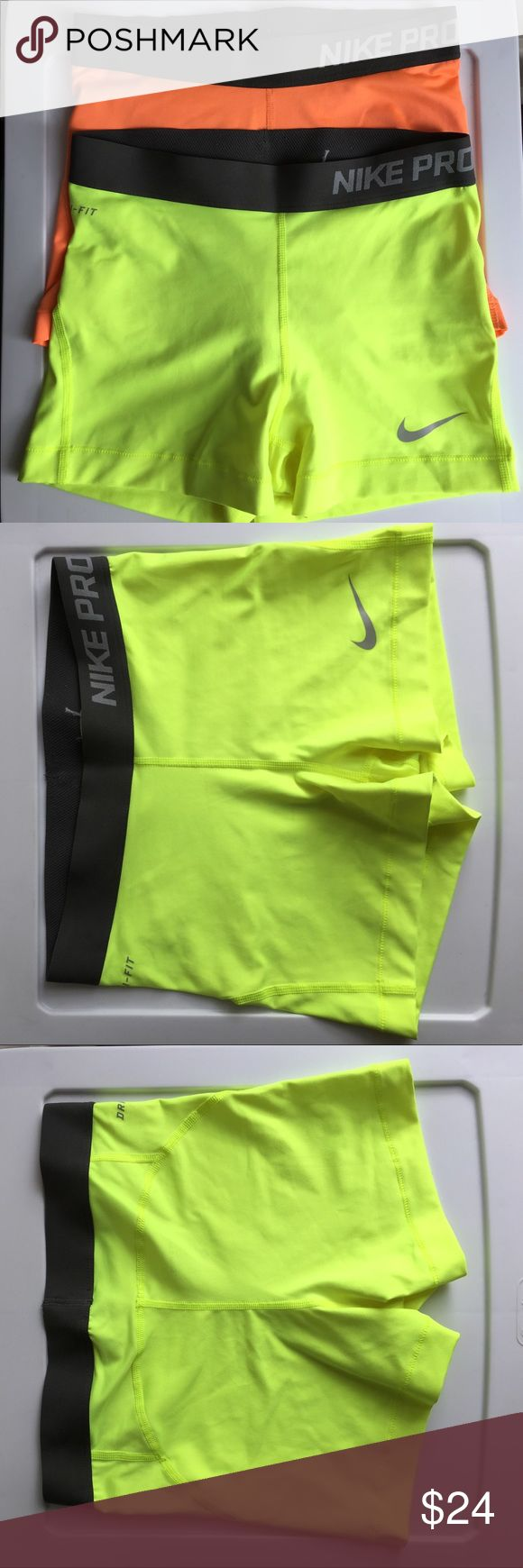 Lot of 2 Nike Pro Dri-Fit spandex shorts Two bright super cute Nike spandex shorts in like-new condition. Band has the Nike Pro logo. I cut the paper tags out inside the yellow pair but the fabric printed tag is still intact with all info. Both are size small. Nike Shorts