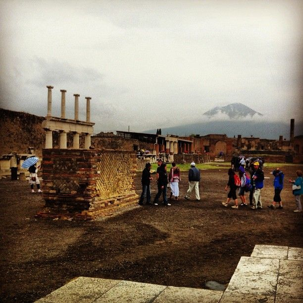 Ruins of Pompeii with Vesuvius looming in the fog #italy #travel
