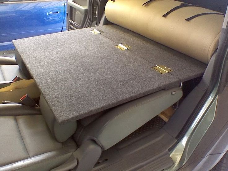 Element Camper Conversion: hinged platform to lay over the front seats