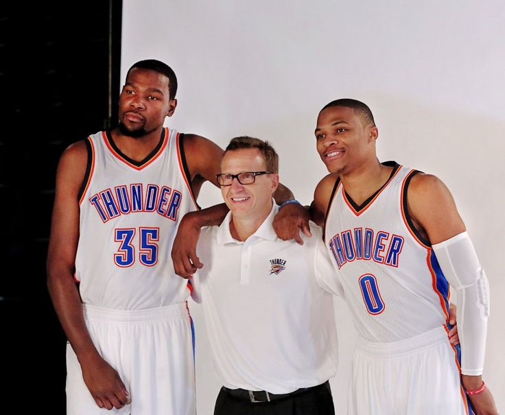 Thunder head coach Scott Brooks is flanked by Kevin Durant, left, and Russell Westbrook at OKC Thunder Media Day in Chesapeake Arena on Monday, Sep. 29, 2014.  Photo by Jim Beckel, The Oklahoman
