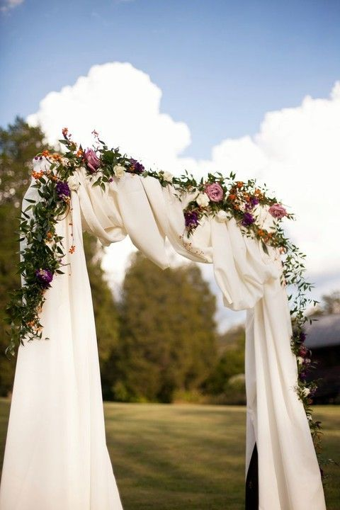 27 Fall Wedding Arches That Will Make You Say 'I Do!': #9. Moody floral arch with white fabric