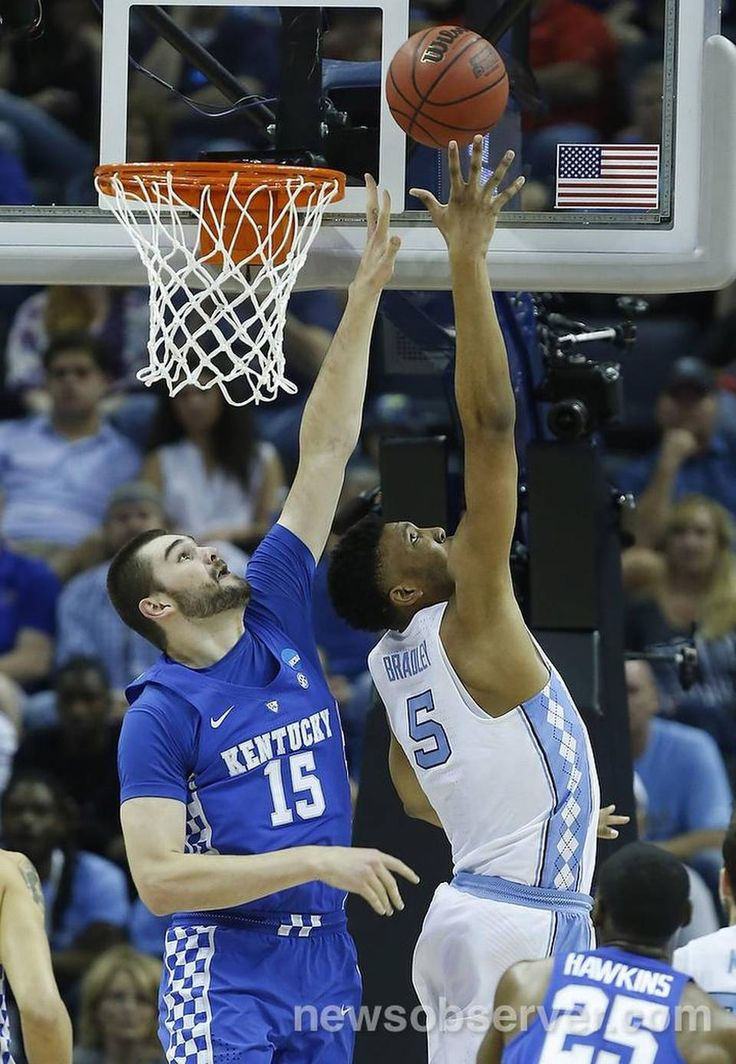 North Carolina's Tony Bradley (5) shoots as Kentucky's Isaac Humphries (15) defends during the first half of UNC's game against Kentucky in the NCAA Tournament South Regional final at FedExForum in Memphis, TN Sunday, March 26, 2017.