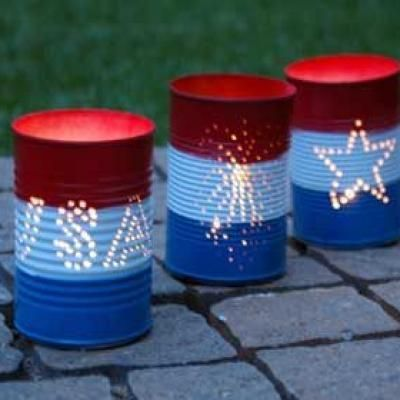 Repurposed Can Luminaries (4th of July) -- I'm thinking of instead of a 4th of July theme, an airplane theme.  Invert the cans and put twinkle lights inside and making patio lights.
