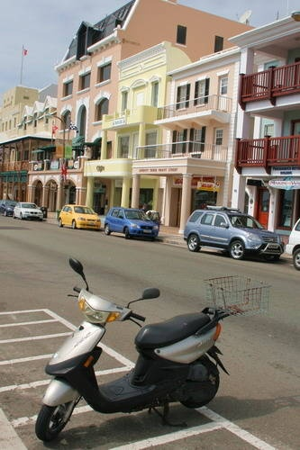 Front Street (Cleanest place I have ever seen) with a view of the Emporium Building.   Hamilton, BERMUDA.