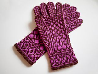 These beautifully patterned gloves were inspired by the spectacular red bud trees that bloom in the springtime in Oklahoma. They are knitted in the round with 2 colors of fingering weight yarn, making a double layer that will keep your hands extra warm. The gloves are knitted from a chart but detailed written instructions are also included with the pattern.