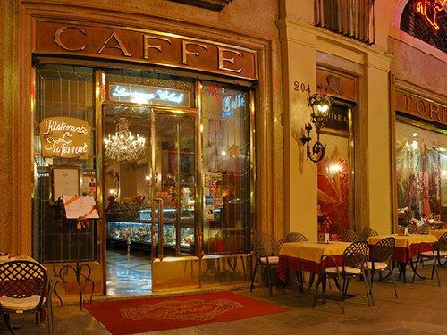 """""""Caffé Torino"""", one of the most ancient cafeterias of the city. Placed in St.Charles square, the Turin's living room, is an historical club. The pavement in front of it has got a metal """"lucky"""" bull, you only have to step on it and hope. The town centre is famed also due to these places, and their tasty coffee."""