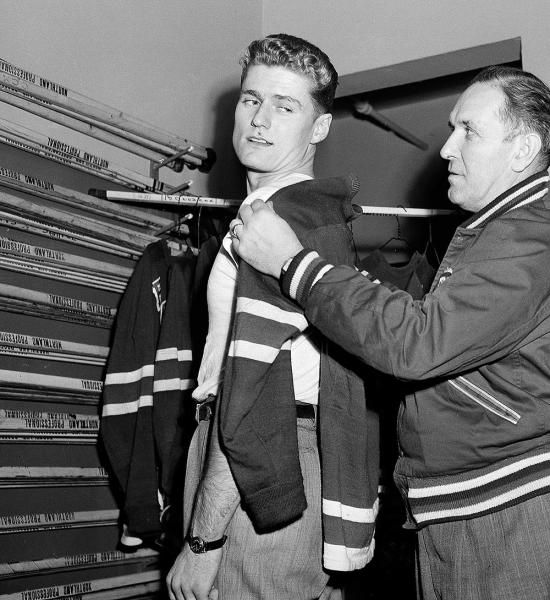 Allan Stanley, left,a Hall of Fame defenseman who won four Stanley Cups with the Toronto Maple Leafs during a 22-year NHL career, has died. He was 87.Stanley started with the New York Rangers in the 1948-49 season and was traded to Chicago during the 1954-55 season. He played in Boston before landing in Toronto before the 1958-59 season.(Anthony Camerano/AP)