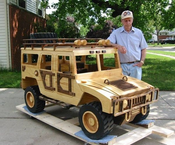 Chuck stands behind an articulated front end loading tractor By Chuck Hoggarth. More Woodworking Projects on www.woodworkerz.com