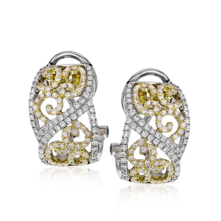 These lovely, intricate earrings combine the both 18k yellow and white gold, cre...