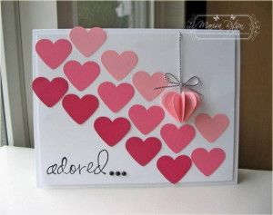 handmade Valentine card ... lots of punched hearts in ombré rows move diagonally down the page ...  one 3-D heart on a string ...