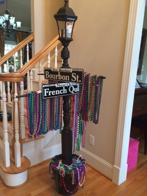 I made this lamp post to hold Mardi Gras beads to pass out.  The lamp post is made from a deck post and the top is from the Restore.