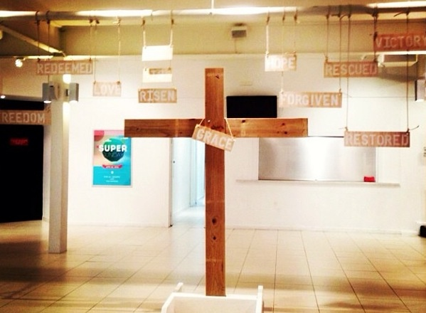 It would be interesting to have a wooden cross placed in the entry way of the church - free standing.  Made of a wood that appeared unfinished or rough - yet was safe for people to touch.  Easter church design. By Rebecca Cox.