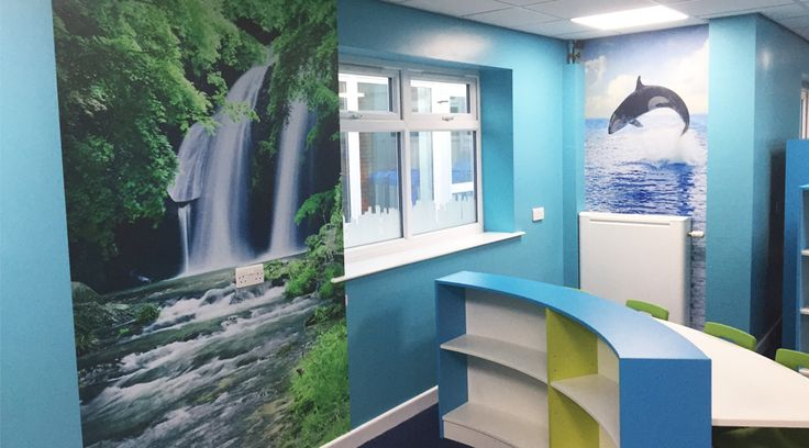 Library wall murals. This waterfall and whale wall murals transform this library, adding a calming water theme to the space and tying the different areas together beautifully. By space3.co.uk