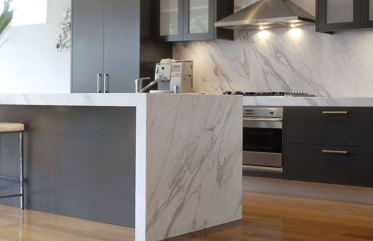 A modern minimalist aesthetic reigns in this kitchen completed by Spazio Marble & Granite. #luxeFL