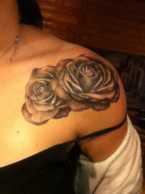 Black and gray photo realistic rose front shoulder tattoo. By Gus at Evolution Tattoo in Spokane, Wa.