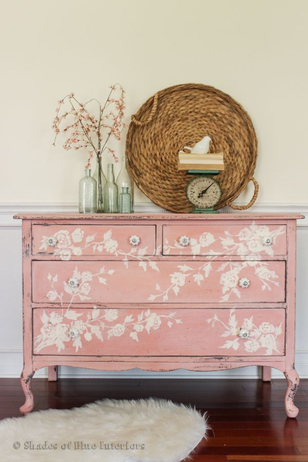 Refresh your bedroom by painting your old dresser. Get creative, like this pale rose creation with a delicate floral pattern on top.