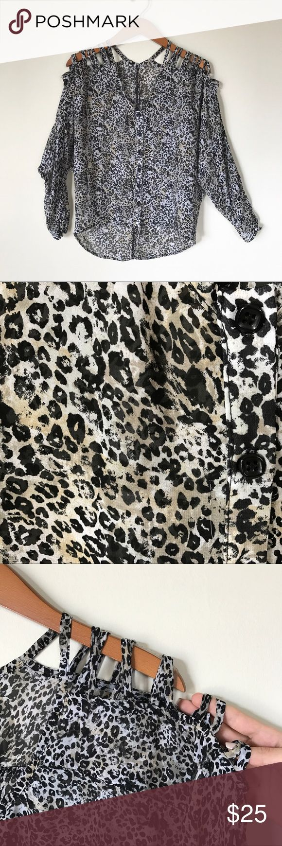Leopard Print Blouse with Cold Shoulder Semi-sheer leopard print blouse with black buttons and cold shoulder design. Black and cream-colored with subtle patches of beige (see close-up photo). Thin straps over shoulders hold the shirt up properly. Blousy one-size-fits-all will work for size small through large. No flaws. Machine washable. MADE IN USA! Black Hearts Brigade Tops Blouses