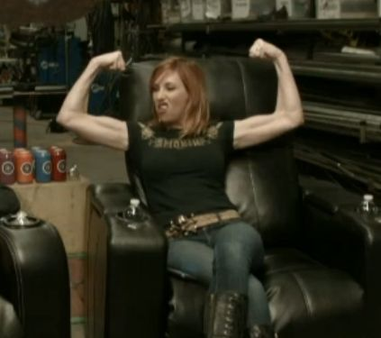 Kari Byron showing off her guns.