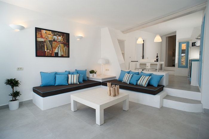 LIVAS PENSION, SANTORINI. Designed to offer pleasurable acommodation to the guests. Different rooms appointed with wooden furniture and with white and blue coloured textiles, creating a cosy atmosphere.