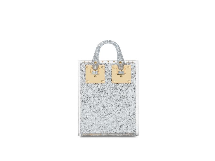 New for Resort 17, the Compton Evening Tote is a high-shine evening bag. Crafted from silver glittered plexiglass and lined in suede, this style is exclusive to SophieHulme.com.
