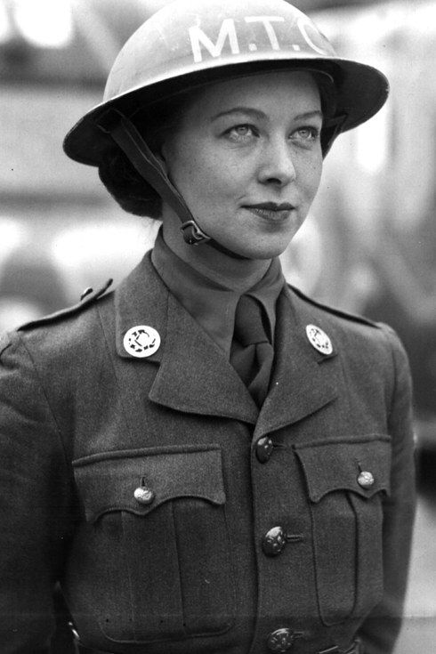 An ambulance driver of the British Women's Auxiliary Army stands at attention in France, 1940